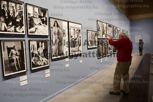 Visitor takes a photo at the exhibition of american fashion photographer Helmut Newton in Budapest, Hungary on April 02, 2013. ATTILA VOLGYI