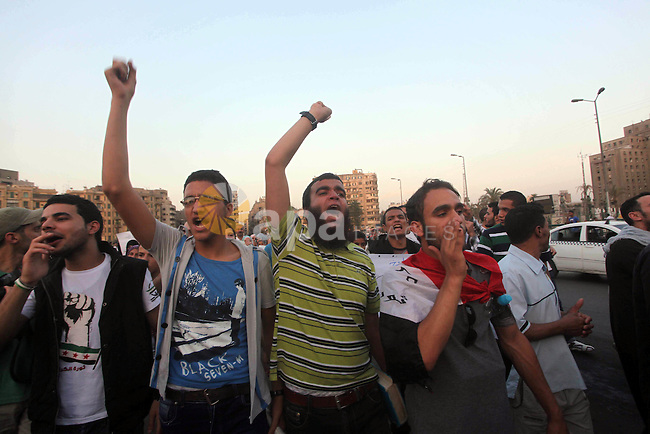 Protesters shout slogans as they protest against the weekend massacre of Houla, in front of the Syrian embassy in Cairo, Egypt, 31 May 2012. A massacre was reported in the central Syrian city of Houla over the weekend, however the government in Damascus denied responsibility. UN observers confirmed on the weekend after visiting Houla that 108 people had died in the town - about one-third of them children - in what activists said was shelling by government forces. Photo by Ashraf Amra