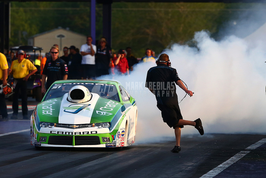 Apr 25, 2014; Baytown, TX, USA; NHRA pro stock driver Dave Connolly does a burnout past a crew member during qualifying for the Spring Nationals at Royal Purple Raceway. Mandatory Credit: Mark J. Rebilas-