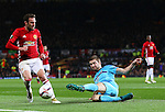 Marko Vejinovic of Feyenoord clears the ball under pressure from Juan Mata of Manchester United during the UEFA Europa League match at Old Trafford, Manchester. Picture date: November 24th 2016. Pic Matt McNulty/Sportimage