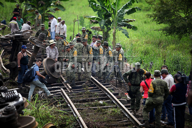 """At least 11 people were killed when a cargo train nicknamed """"La Bestia,"""" or """"The Beast,"""" on which would-be migrants hitch rides toward the U.S. border, derailed in a remote area of southern Mexico on Sunday August 26th 2013. Every year, thousands of undocumented migrants cling to the wagons of """"the Beast"""", a freight train that runs from southern Mexico to the US-Mexican border, braving bandits, immigration officials and the elements to reach """"El Norte""""."""