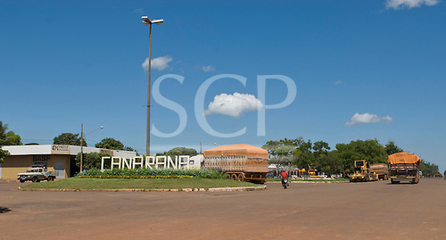 Canarana, Mato Grosso State, Brazil. Soya truck passing the town sign.