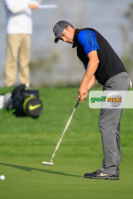 Ross Fisher (ENG) takes his putt on the 16th green during Sunday's Final Round of the 2014 BMW Masters held at Lake Malaren, Shanghai, China. 2nd November 2014.<br /> Picture: Eoin Clarke www.golffile.ie