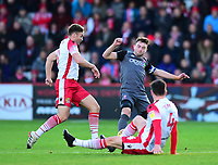 Lincoln City's Lee Frecklington battles with  Stevenage's Joel Byrom, left, and Michael Timlin<br /> <br /> Photographer Andrew Vaughan/CameraSport<br /> <br /> The EFL Sky Bet League Two - Stevenage v Lincoln City - Saturday 8th December 2018 - The Lamex Stadium - Stevenage<br /> <br /> World Copyright © 2018 CameraSport. All rights reserved. 43 Linden Ave. Countesthorpe. Leicester. England. LE8 5PG - Tel: +44 (0) 116 277 4147 - admin@camerasport.com - www.camerasport.com