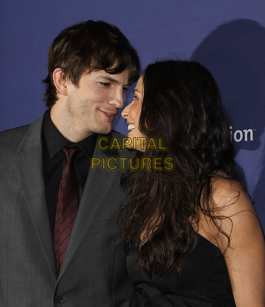 "ASHTON KUTCHER & DEMI MOORE.18th Annual ""A Night at Sardi's"" Benefitting The Alzheimer's Association held At The Beverly Hilton Hotel, Beverly Hills, California, USA..March 18th, 2010.half length grey gray suit black dress married husband wife profile .CAP/ADM/KB.©Kevan Brooks/AdMedia/Capital Pictures."