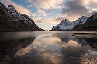 Winter mountain reflection in Bunesfjord at low tide, Vindstad, Moskenesøy, Lofoten Islands, Norway