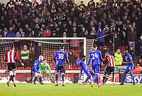 Sheffield United's forward Leon Clarke (9) strikes to put Sheffield United 1-0 up during the Sky Bet Championship match between Sheff United and Cardiff City at Bramall Lane, Sheffield, England on 2 April 2018. Photo by Stephen Buckley / PRiME Media Images.
