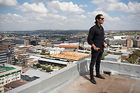 MABONENG, SOUTH AFRICA - MARCH 22: Property developer Jonathan Liebmann stands for a portrait on the rooftop in one of his latest projects, Hallmark House in Maboneng district on March 22, 2016 in downtown Johannesburg, South Africa. The building is the idea of Mr. Liebmann and celebrated architect David Adjaye. Maboneng is mostly owned and controlled by Mr. Liebmann. A former derelict industrial area, and a no-go area after dark, Maboneng is now a vibrant area with artists, businesses, galleries and tourists. A racially mixed cultural hub with markets on the weekend. (Photo by Per-Anders Pettersson/Getty Images)