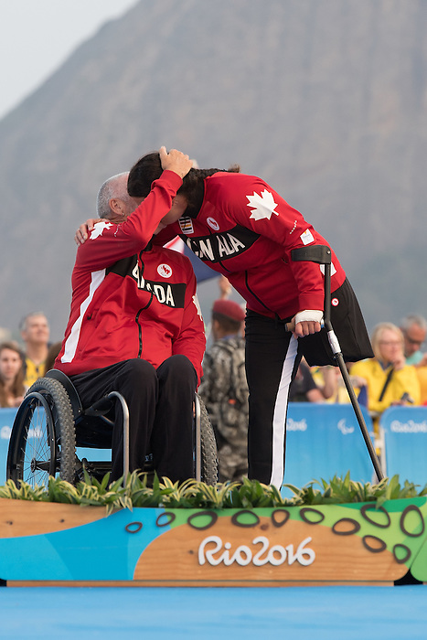 RIO DE JANEIRO - 17/9/2016: John McRoberts and Jackie Gay receive their silver medals for the 2-Person Keelboat (SKUD18) at the Marina da Gloria during the Rio 2016 Paralympic Games in Rio de Janeiro, Brazil. (Photo by Matthew Murnaghan/Canadian Paralympic Committee)
