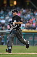 Home plate umpire Brian Reilly runs to his position during the game between the Fresno Grizzlies and the Salt Lake Bees in Pacific Coast League action at Smith's Ballpark on May 25, 2014 in Salt Lake City, Utah.  (Stephen Smith/Four Seam Images)