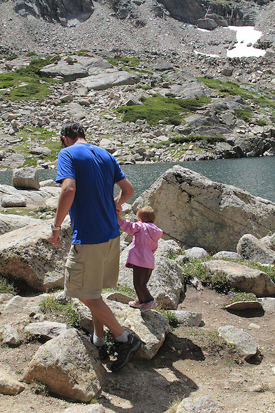 Father and daughter hiking in Indian Peaks Wilderness Area, west of Boulder, Colorado, USA.