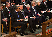 United States President Barack Obama, left, listens to Vice President Joe Biden, center, and former President Bill Clinton, center right, before the start of the funeral service for the late U.S. Senator Daniel Inouye (Democrat of Hawaii) at the Washington National Cathedral in Washington, DC, USA, 21 December 2012. Inouye, a World War II veteran, was the second-longest serving senator in history..Credit: Jim LoScalzo / Pool via CNP