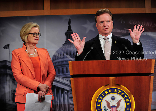 United States Senators Claire McCaskill (Democrat of Missouri), left, and Jim Webb (Democrat of Virginia), right, hold a press conference in the U.S. Capitol on their wartime contracting legislation.  The legislation is intended to reform contracting practices during overseas military operations, institute contractor accountability and requiring greater transparency, competition, and workforce education..Credit: Ron Sachs / CNP