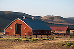 Red wooden barn with ventilator, central Oregon.