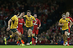 Outside half Bernard Foley celebrates with Adam Ashley-Cooper after kicking a late drop goal to give Australia the lead.<br /> Dove Men Series 2014<br /> Wales v Australia<br /> Millennium Stadium<br /> 08.11.14<br /> &copy;Steve Pope-SPORTINGWALES