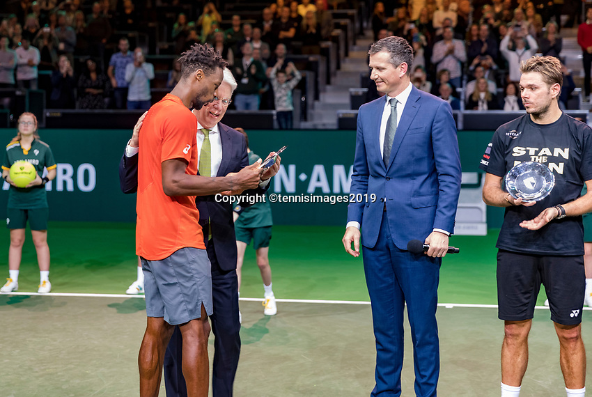 Rotterdam, The Netherlands, 17 Februari 2019, ABNAMRO World Tennis Tournament, Ahoy,  award ceremony, Winner Gael Monfils (FRA) gets the trophy handed over from the CEO of the ABNAMRO Bank Kees van Dijkhuizen , in the middle tournament director Richard Krajicek and right runner up Stan Wawrinka (SUI)<br /> Photo: www.tennisimages.com/Henk Koster