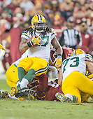 Green Bay Packers running back Eddie Lacy (27) is tackled by Washington Redskins defensive end Jason Hatcher (97) and Washington Redskins inside linebacker Will Compton (51) in first quarter action during an NFC Wild Card game at FedEx Field in Landover, Maryland on Sunday, January 10, 2016.  The Packers won the game 35 - 18.<br />