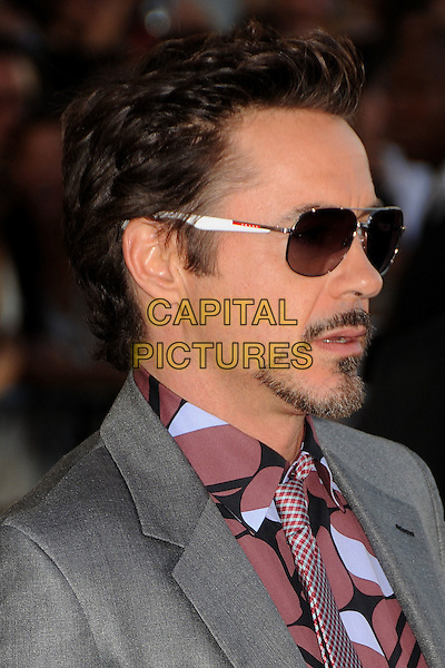 "Robert Downey Jr..Premiere of ""Captain America: The First Avenger"" held at The El Capitan Theatre in Hollywood, California, USA..July 19th, 2011.headshot portrait pink grey gray sunglasses shades goatee facial hair profile .CAP/ADM/BP.©Byron Purvis/AdMedia/Capital Pictures."