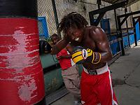 HAVANA, CUBA - JUNE 15: Cuban boxer, Maikel L. Masso, trains as his coach watches, at a boxing gymnasium in Old Havana, Habana Vieja on June 15, 2015 in Havana, Cuba. <br /> Daniel Berehulak for Panasonic/Lumix
