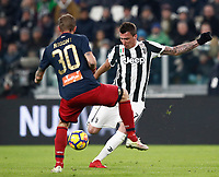 Calcio, Serie A: Juventus - Genoa, Torino, Allianz Stadium, 22 gennaio 2018. <br /> Juventus Mario Mandzukic (r) in action with Genoa's Luca Rigoni (r) during the Italian Serie A football match between Juventus and Genoa at Torino's Allianz stadium, January 22, 2018.<br /> UPDATE IMAGES PRESS/Isabella Bonotto