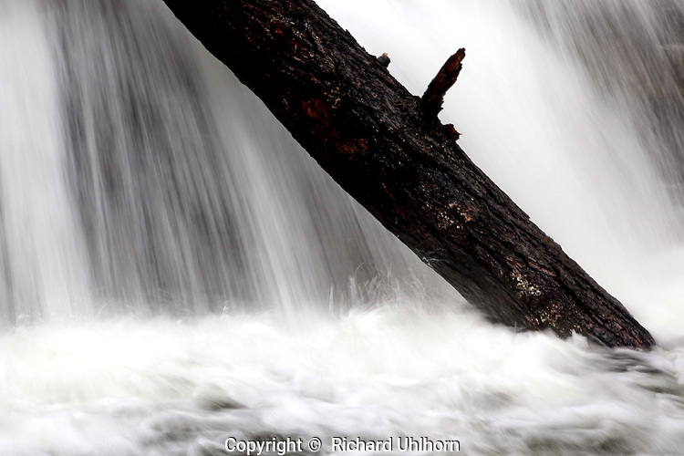 Water flows smoothly over the lower falls at Rainbow Falls in the Stehekin Valley.