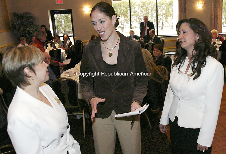 WATERBURY, CT. 08 March 2007--04_NEW_030807SV02--From left, Lori Rotella, president of the Laurel Chapter of the Women&rsquo;s Council of Realtors, talks with former WNBA and UConn basketball star Rebecca Lobo, now spokeswoman for McCue Mortgage company, and Lisa A. Bookman of McCue Mortgage at the Ponte Club in Waterbury. Lobo was the speaker at the Women's Council of Realtors luncheon Thursday. <br /> Steven Valenti Republican-American