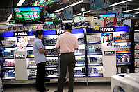 NIVEA, a global skin- and body-care brand, in a Wu Mart supermarket in Beijing, China.  Wu Mart, the Beijing-based chain, was founded in the early 1990s by Zhang Wenzhong. Its name smacks of the fame of U.S. retail giant Wal-Mart. Wu Mart and Wal-Mart are competing in different arenas and each appears to be going after a different class of consumer. By 2005, Wu Mart had more than 450 hypermarkets, supermarkets and convenience stores, and is one of only a few Chinese retailers whose shares are publicly traded..02 June 2011