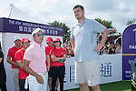 Tenniel Chu (left) and Yao Ming at the 1st hole during the World Celebrity Pro-Am 2016 Mission Hills China Golf Tournament on 22 October 2016, in Haikou, China. Photo by Marcio Machado / Power Sport Images