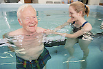 Physiotherapist working with an upper limb patient in hydrotherapy pool.  MR