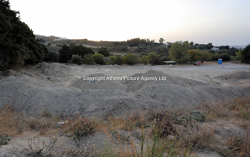 Pictured: Mounts of rubble and soil left at the farmhouse site where Ben Needham disappeared from in Kos, Greece. <br />