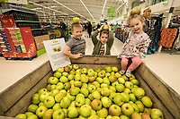 George, 6, Edward, 5 and Heidi Johnson, 2 with their free Bramley Apples