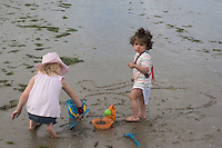 Safina on the beach at Bettystown  beside Morgan who digging the sand filling a bucket  2nd Aug 2007