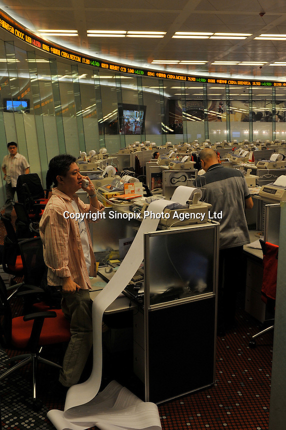Staff working in Hong Kong Exchange in Hong Kong, China. The Hang Seng Index rise of 165 points in Hong Kong, a 5.3% gain and has lost just 3 % of its value since the beginning of the American Financial Crisis triggered by the collapse of AIG. .