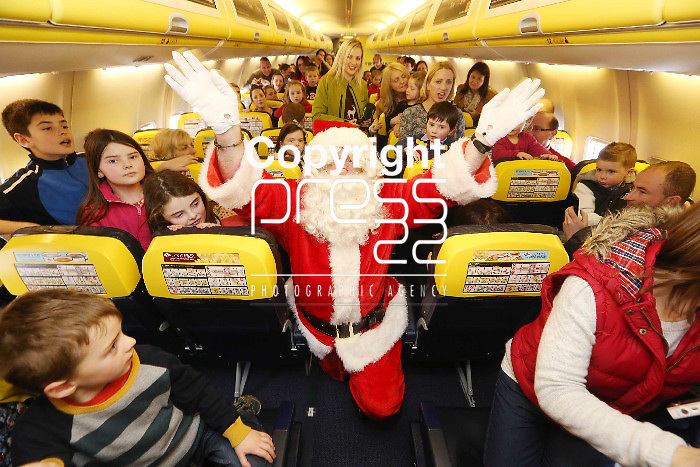 Free Pics   With Compliments Santa Appears on the 11.40 Ryanair Santa Flight from Shannon Airport to the delight of all the children on board to 40 minute flight on Sunday as Ryanair and Shannon Airport joined forces with Santa and his elves to offer free flights to the young and the young at heart to meet with the man himself as a thank you to the people of the midwest. Pic. Brian Arthur/ Press 22.