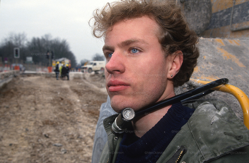 Jason Torrance attached with U-lock to plant machinery in the Cutting. Road Protest actions at Twyford Down, near the Donga pathways, outside Winchester, against the M3 road extension. 1992-94<br />