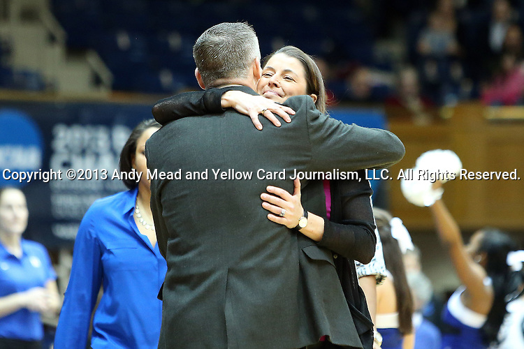 27 January 2013: Duke head coach Joanne P. McCallie (behind) and Boston College head coach Erik Johnson hug before the game. The Duke University Blue Devils played the Boston College Eagles at Cameron Indoor Stadium in Durham, North Carolina in an NCAA Division I Women's Basketball game. Duke won the game 80-56.
