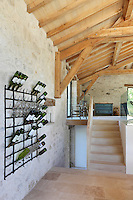 The 'wine grading rack' for storing empty wine bottles in order of those the couple enjoyed the best