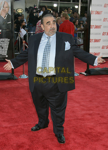"KEN DAVITIAN.""Get Smart"" Los Angeles Premiere held at Mann's Village Theatre, Westwood, California, USA..June 16th, 2008.full length black pinstripe suit hand in pocket hands arms outstretched .CAP/ADM/MJ.©Michael Jade/AdMedia/Capital Pictures."