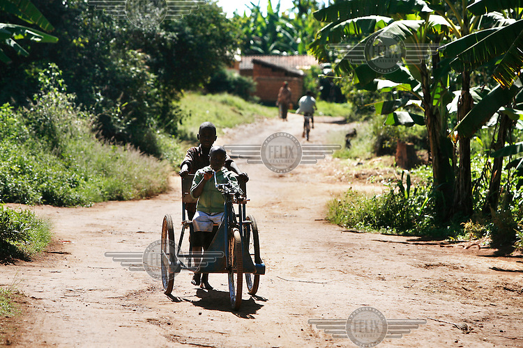 Nine year old Gervais Bugaru from Ruyigi was born with two clubfeet, a congenital deformity of the foot. After having an infection in his legs, both had to be amputated in 2007. Since than Gervais has learned to walk very fast on his powerful arms. In 2008 he received a tricycle from Handicap International. To make the ascent up towards the main road he needs help from a friend, but after that he can go on his own to the school or market.