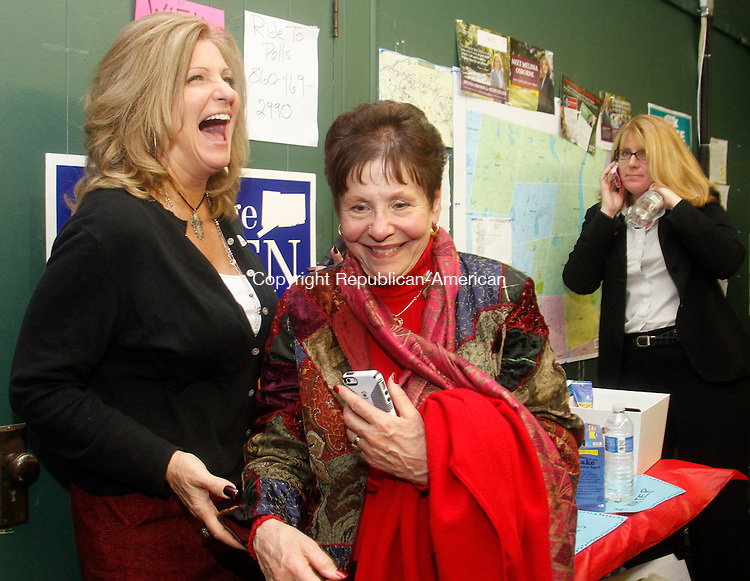 Torrington, CT- 04 November 110414MK012 Marie Soliani (right) shares a light moment with her supportors at her Democratic headquaters in Torrington Tuesday night.  Soliani was defeated by Jay Case for the 63RD race. Michael Kabelka / Republican-American