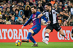 Lionel Andres Messi (L) of FC Barcelona is tackled by Ivan Lopez Alvarez, Ivi, of Levante UD  during the La Liga 2017-18 match between FC Barcelona and Levante UD at Camp Nou on 07 January 2018 in Barcelona, Spain. Photo by Vicens Gimenez / Power Sport Images
