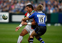 Photo: Richard Lane/Richard Lane Photography. Bath Rugby v Biarritz Olympique. Heineken Cup. 10/10/2010. Biarritz' Raphael Lakafia passes as he is tackled by Bath's Nick Abendanon.