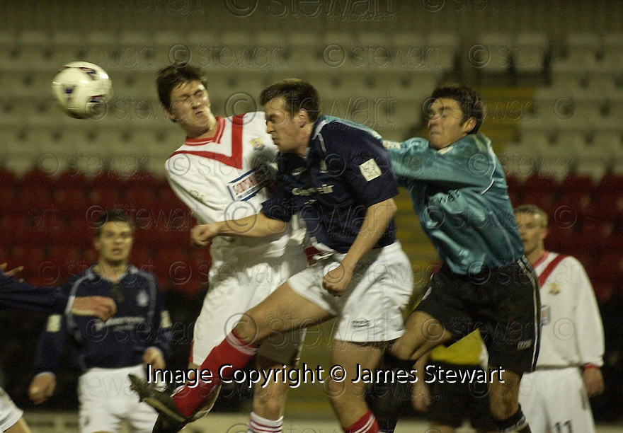 12/03/2002                 Copyright Pic : James Stewart .Ref :     .File Name : stewart-airdrie v falkirk 02.FALKIRK KEEPER DARREN HILL PUNCHES THE BALL AWAY AS KEVIN CHRISTIE AND KEVIN JAMES MAKE THE CHALLENGE,,,.James Stewart Photo Agency, Stewart House, Stewart Road, Falkirk. FK2 7AS      Vat Reg No. 607 6932 25.Office     : +44 (0)1324 630007     .Mobile  : + 44 (0)7721 416997.Fax         :  +44 (0)1324 630007.E-mail  :  jim@jspa.co.uk.If you require further information then contact Jim Stewart on any of the numbers above.........