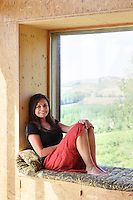 Architect Vicky Thornton on a window seat in the living area