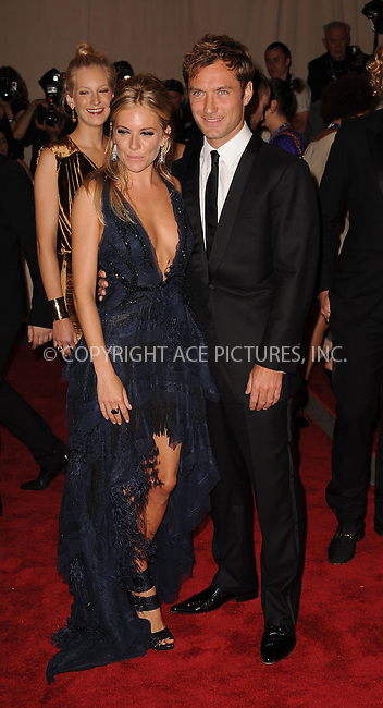 WWW.ACEPIXS.COM . . . . . ....May 3 2010, New York City....Jude Law and Sienna Miller arriving at the Costume Institute Gala Benefit to celebrate the opening of the 'American Woman: Fashioning a National Identity' exhibition at The Metropolitan Museum of Art on May 3, 2010 in New York City.....Please byline: KRISTIN CALLAHAN - ACEPIXS.COM.. . . . . . ..Ace Pictures, Inc:  ..(212) 243-8787 or (646) 679 0430..e-mail: picturedesk@acepixs.com..web: http://www.acepixs.com