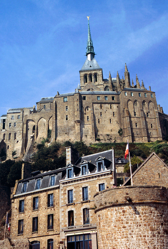 The island, spire of the abbey at its highest point, seen from the causeway, Mont. St. Michel, Normandy, France