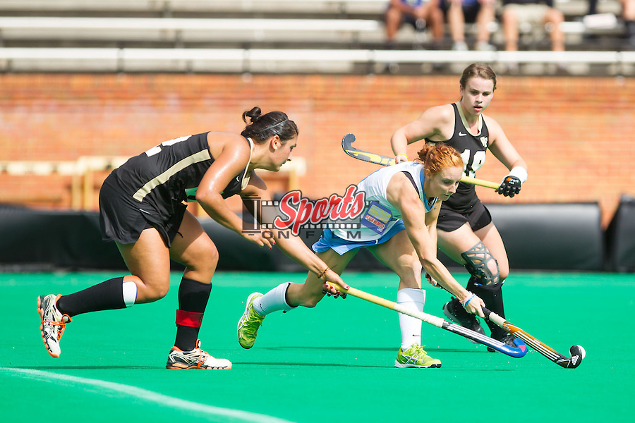 Sinead Loughran (11) of the North Carolina Tar Heels tries to keep the ball away from Anna Kozniuk (22) of the Wake Forest Demon Deacons at Kentner Stadium on October 12, 2013 in Winston-Salem, North Carolina.  The Demon Deacons defeated the Demon Deacons 4-2.  (Brian Westerholt/Sports On Film)