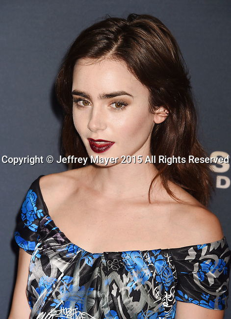 HOLLYWOOD, CA - SEPTEMBER 08: Actress Lily Collins  arrives at the Premiere Of The Vladar Company's 'Jeremy Scott: The People's Designer' at TCL Chinese 6 Theatres on September 8, 2015 in Hollywood, California.