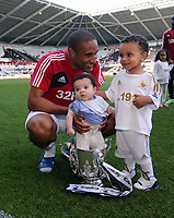 Pictured: Swansea captain Ashley Williams with his two children and the Capital One Cup after the end of the game. Sunday 19 May 2013<br /> Re: Barclay's Premier League, Swansea City FC v Fulham at the Liberty Stadium, south Wales.