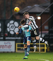 Matt Tootle of Notts Co beats Joe Jacobson of Wycombe Wanderers to the ball during the Sky Bet League 2 match between Notts County and Wycombe Wanderers at Meadow Lane, Nottingham, England on 10 December 2016. Photo by Andy Rowland.